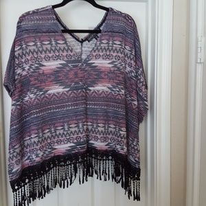 Poncho top with fringe hem